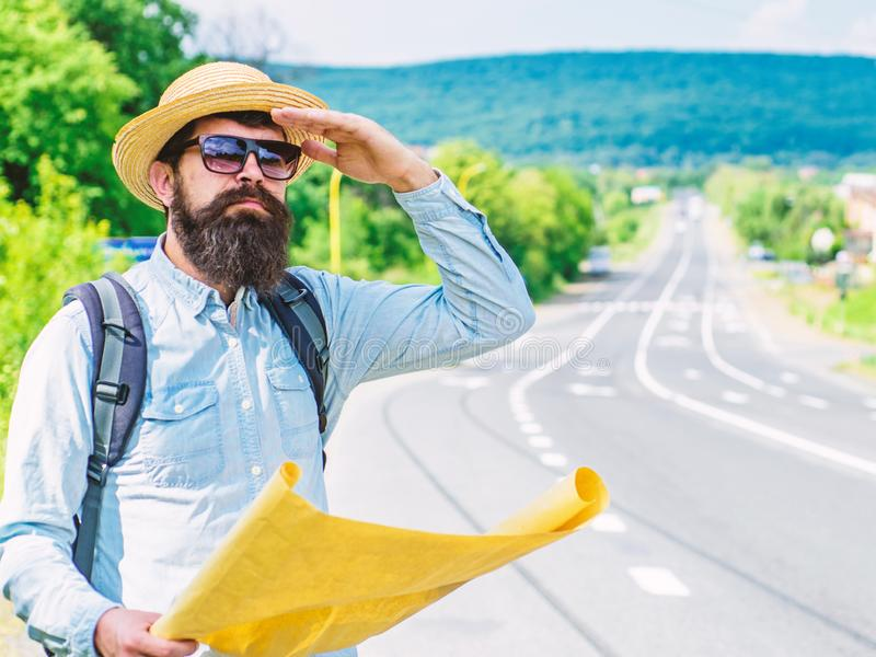 Backpacker man travelling by hitchhiking on his own. What is there. Tourist with map see familiar landmark. Seems. Finally got destination point. Tourist try to royalty free stock photo
