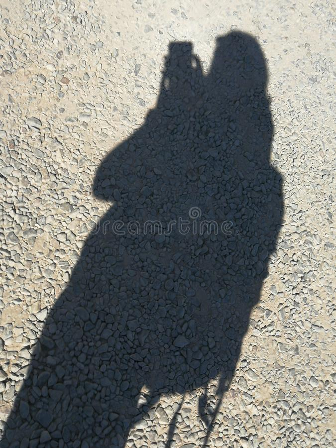 Backpacker shadow adventure traveller solo single one man band mobile phone stock photo