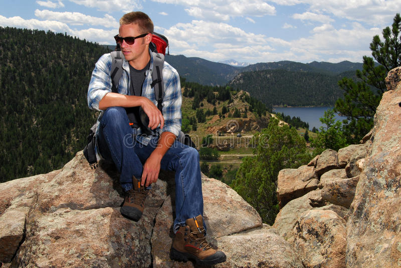 Backpacker On Top Of A Mountain Stock Photo
