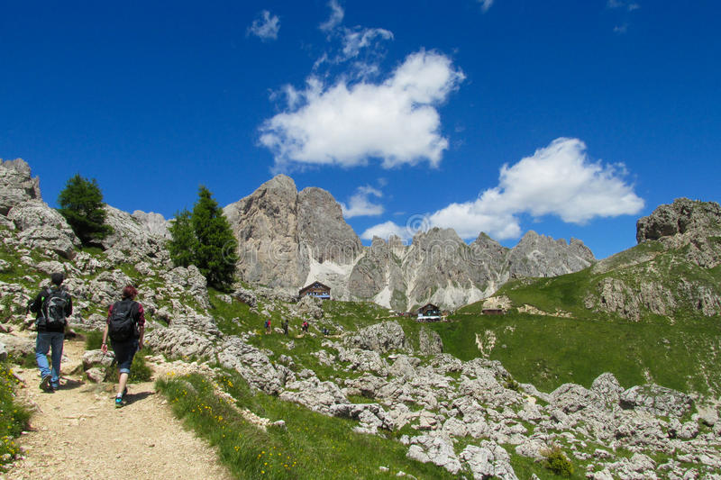 Backpacker trekking tourists in the Alps royalty free stock image
