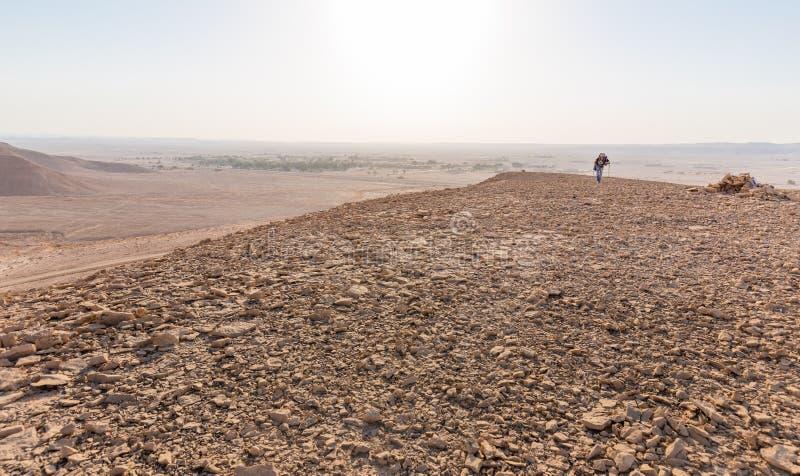Backpacker walking hiking tourist man desert mountain, Middle East. Man backpacker tourist hiking walking stone desert traveling Israel Middle East mountains stock photos