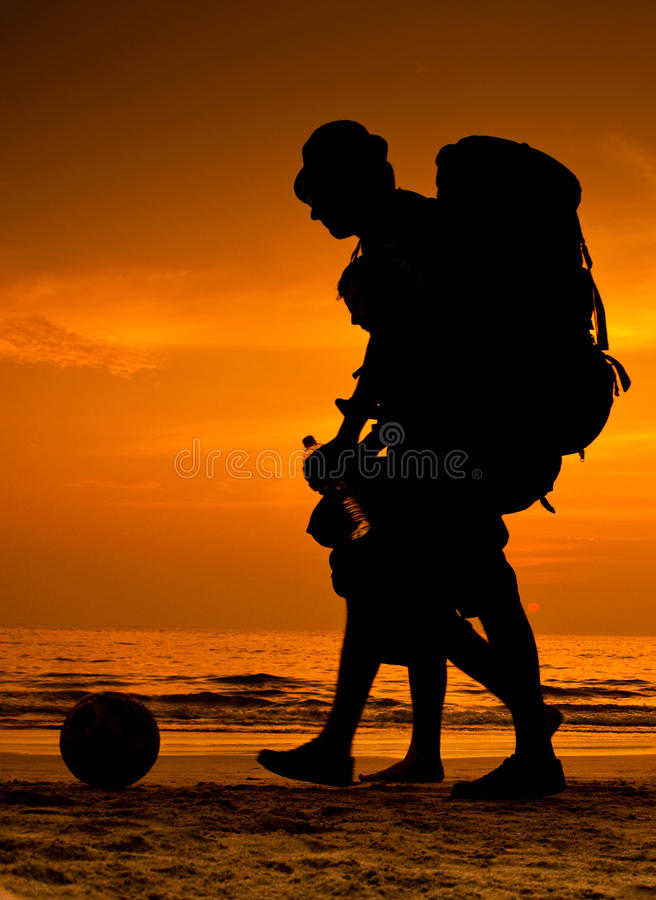 Backpackers On The Beach Stock Photo