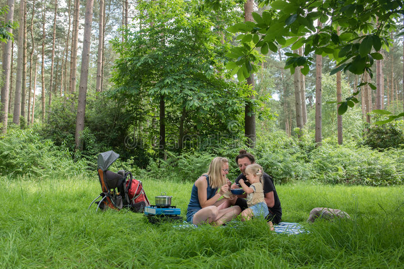 Backpackers family dining in nature. Happy family having dinner in woodland.Camping family concept royalty free stock photos