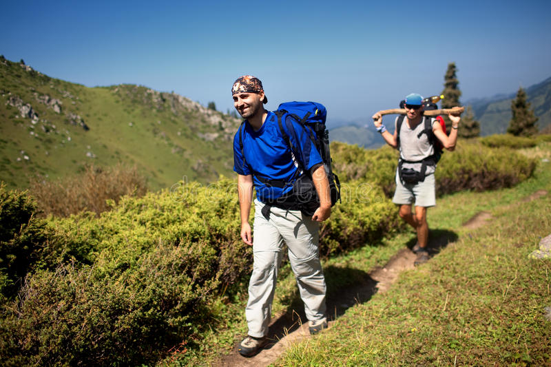 Backpackers in mountain royalty free stock images