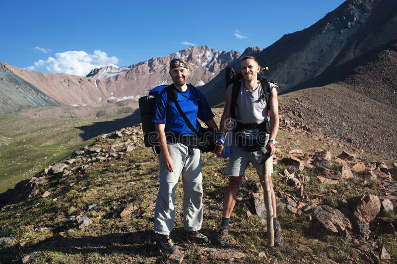 Backpackers in mountain royalty free stock photo