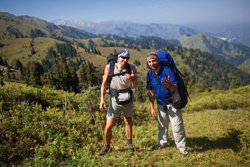 Backpackers in mountain royalty free stock photography