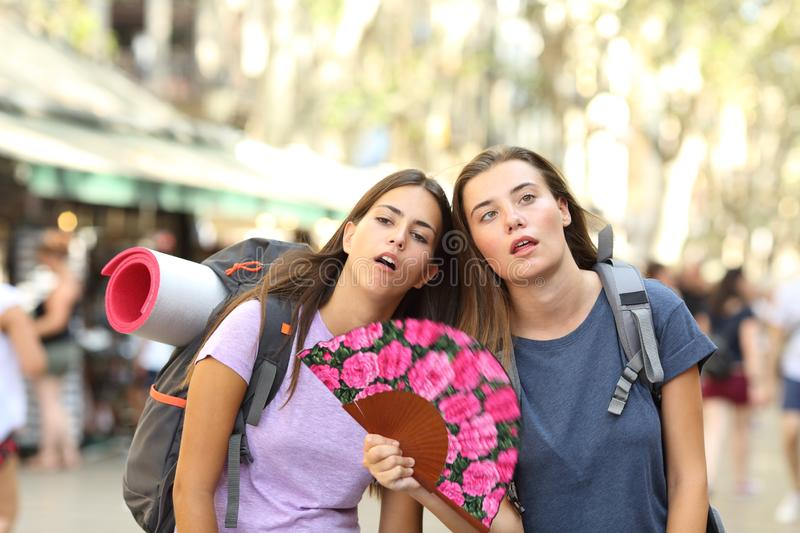 Backpackers suffering heat stroke on vacation stock photos