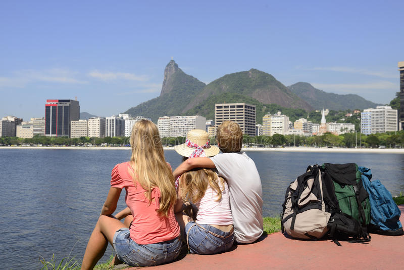 Download Backpackers Tourists In Rio De Janeiro Looking At Christ The Redeemer. Stock Image - Image: 35926707