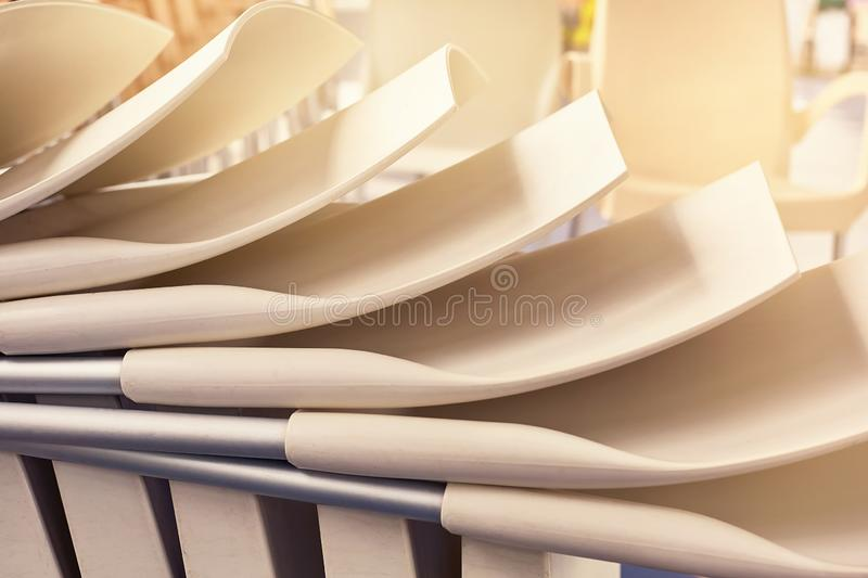 The backs of chairs placed on top of each other royalty free stock image