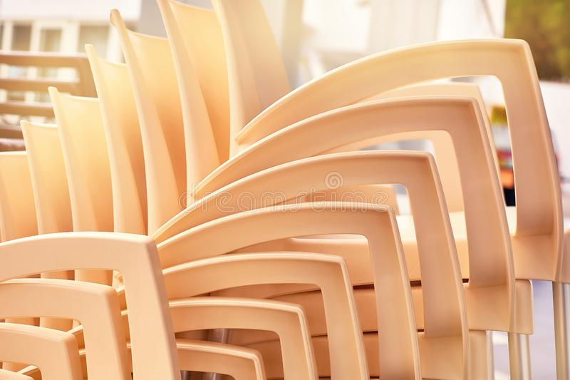 The backs of chairs placed on top of each other royalty free stock photography