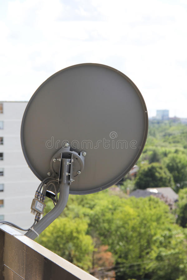 The backside of satellite dish at the high-rise bu. Ilding stock images