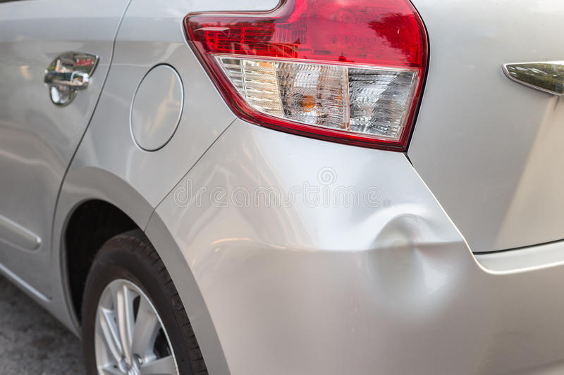 Backside of silver car get damaged by accident stock photos