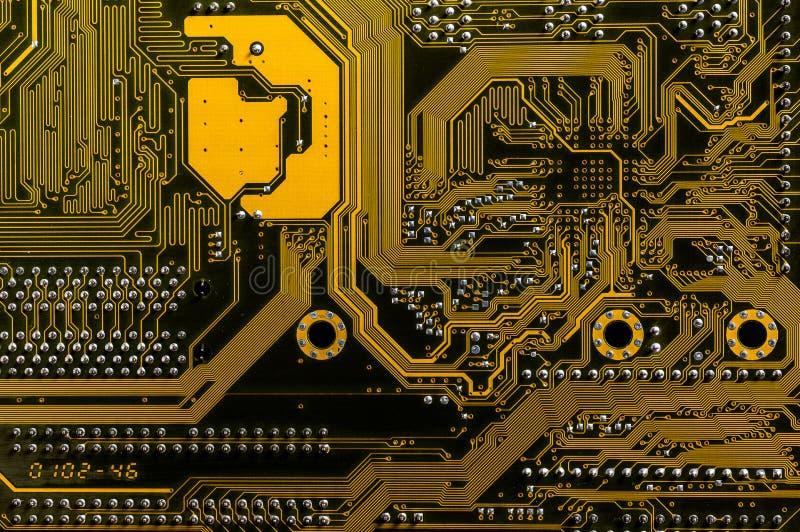 Backside yellow motherboard stock photos