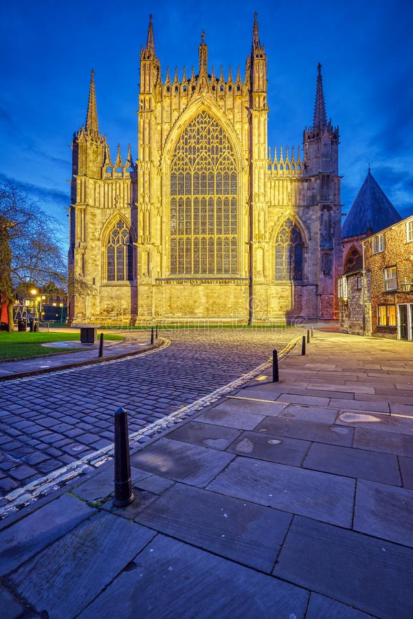 The backside of the York Minster. And some half-timbered houses at dusk stock image