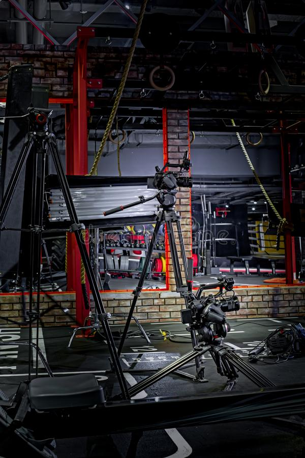 Backstage of video production professional video cameras. Backstage video production professional cameras in the gym royalty free stock photo