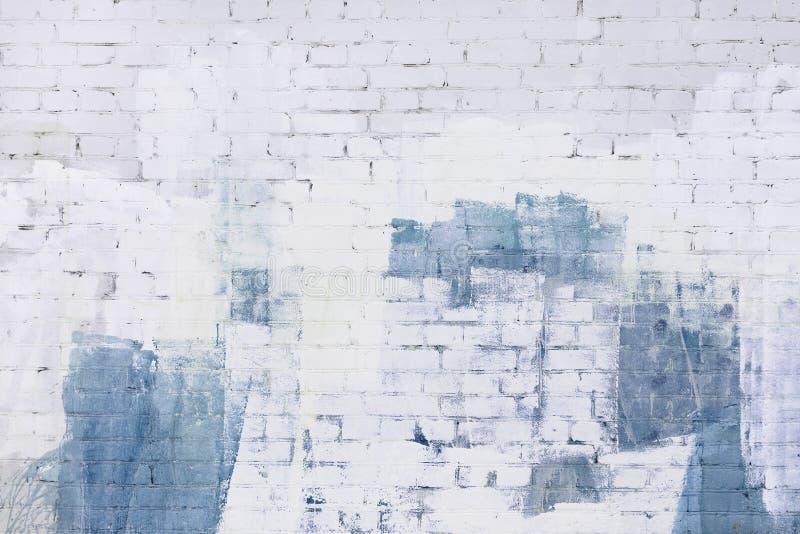 Backsteinmauer abstrakt gemalt mit weißer und blauer Farbe Hintergrund, Beschaffenheit lizenzfreies stockbild