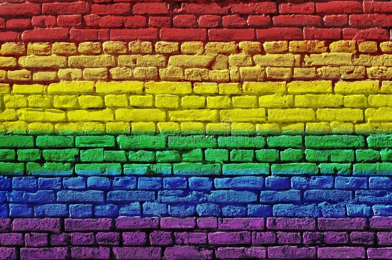 Backsteinmauer gemalt in Gr?nem, in Gelbem und in Rotem Rastafarian Markierungsfahne lizenzfreies stockfoto
