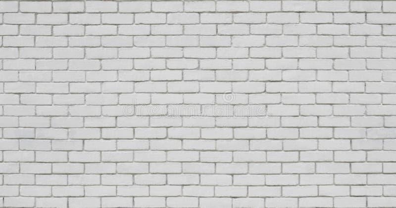 Backsteinmauer im Weiß stockfotografie