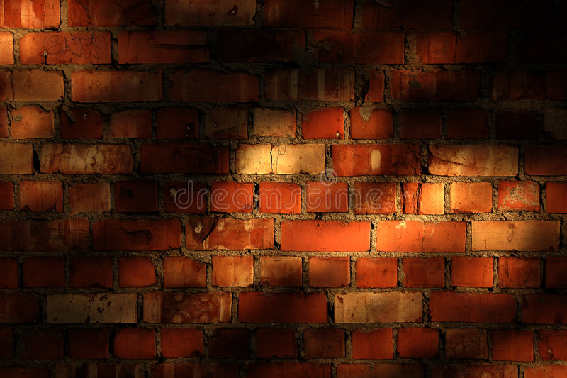 Backsteinmauer Mit Abendschatten Stockfotos