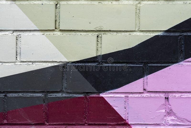 Backsteinmauer wird mit abstrakter Zeichnungsfarbennahaufnahme verziert Detail mögen als Graffiti Fragment f?r Hintergrund lizenzfreie stockfotografie