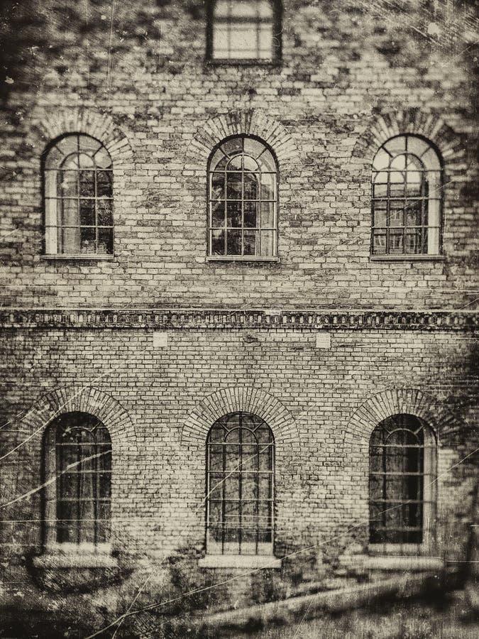 Backsteinmauerfenster stockfotos