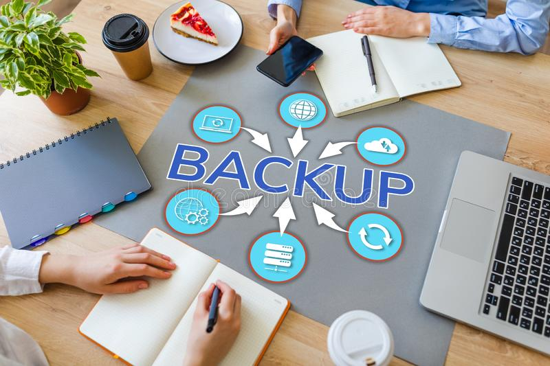 Backup user data security recovery internet technology concept on office desktop. royalty free stock photo