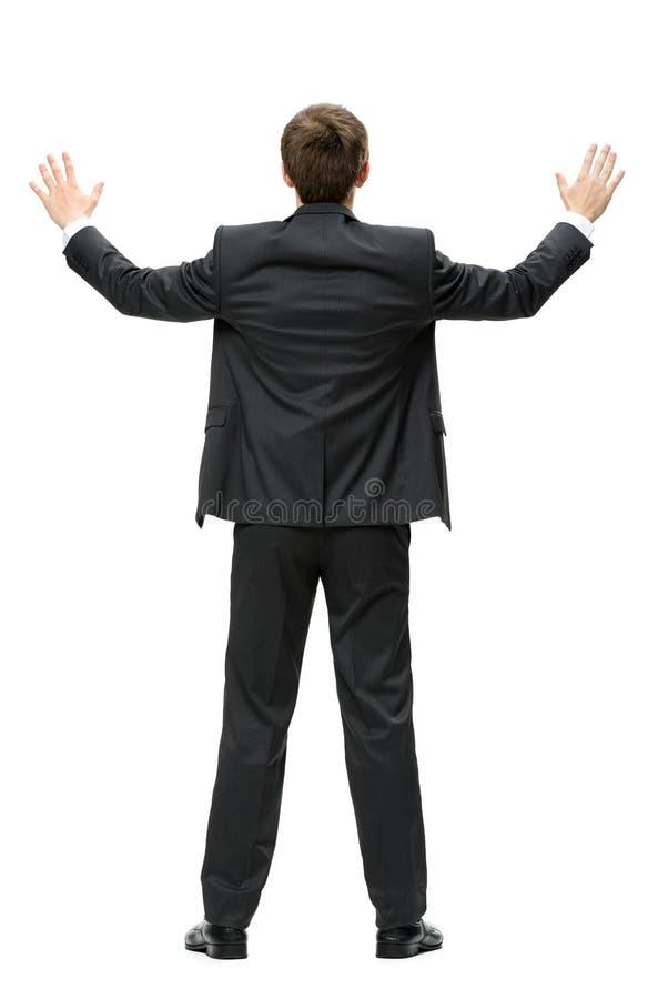 Backview av affärsmannen med händer upp arkivfoton