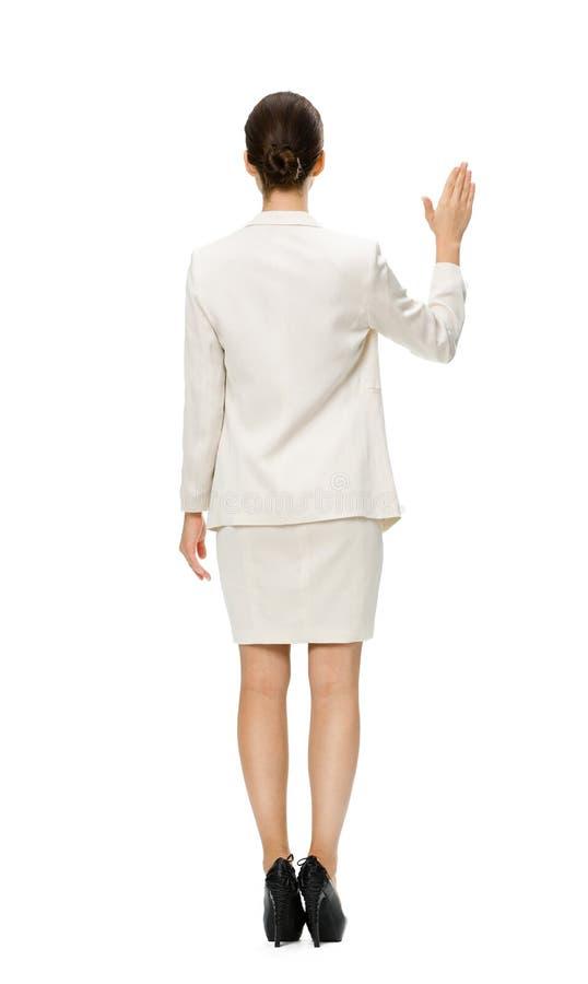 Backview completo da mão de ondulação da mulher de negócios imagens de stock