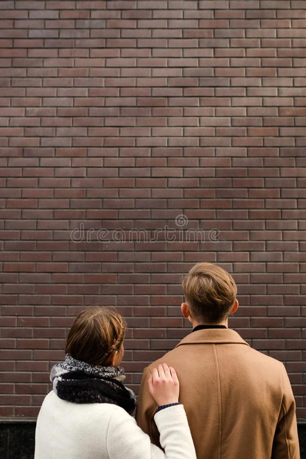 Backview couple look up advertising promotion royalty free stock images