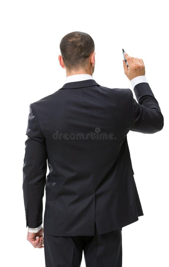 Backview de la escritura del hombre de negocios con el marcador foto de archivo libre de regalías