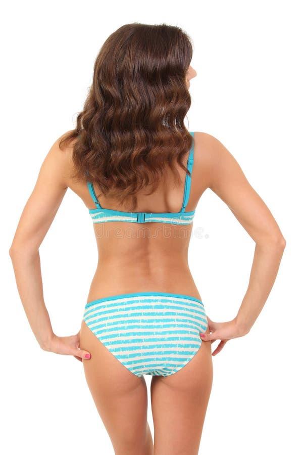 Backview del bikini que lleva femenino imagenes de archivo
