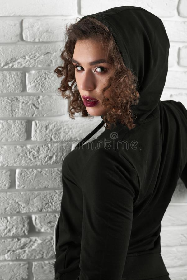 Backview of passionate curly model looking at camera. royalty free stock photo