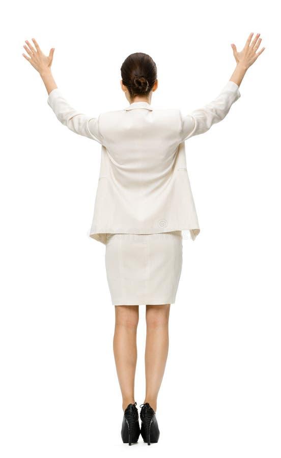 Backview van gemiddelde lengte van onderneemster met omhoog handen stock foto's
