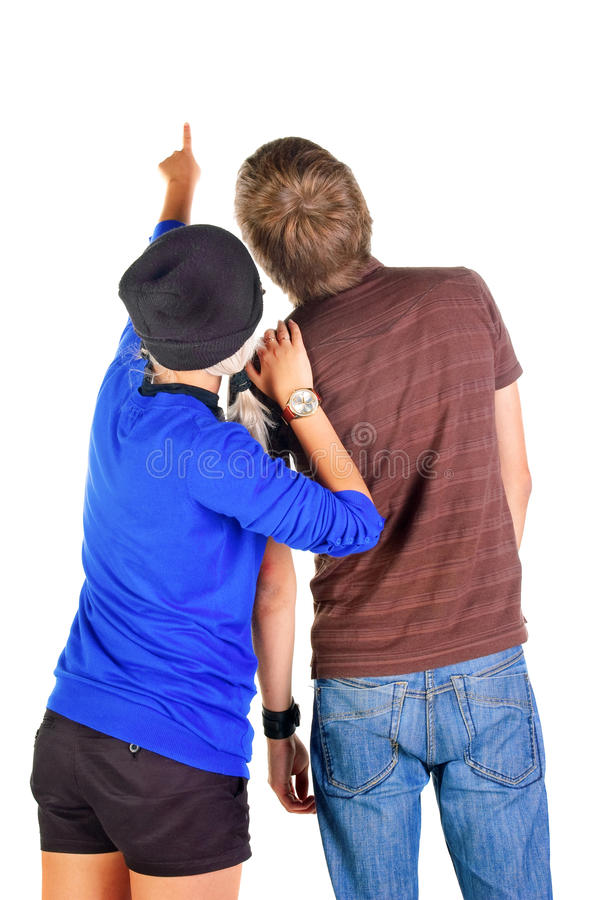 Backview of young couple interestedly looks at white. royalty free stock photo