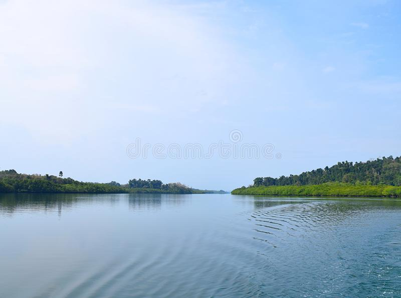 Backwater with Greenery on Banks with Clear Water and Blue Sky - River on Great Andaman Trunk Road, Baratang Island, India royalty free stock photography
