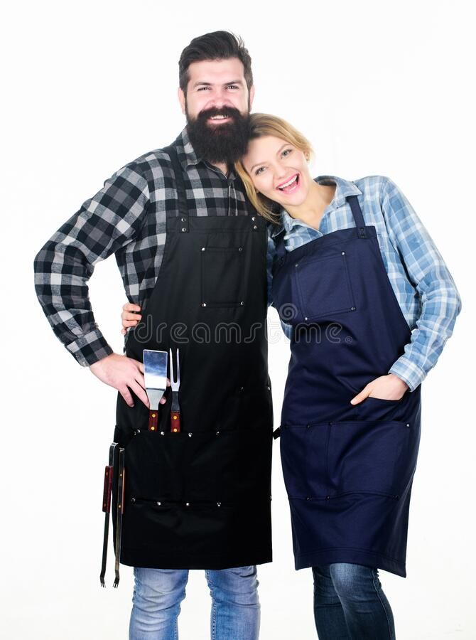 Backyard barbecue party. American food tradition. Cooking together. Couple in love getting ready for barbecue. Man royalty free stock images