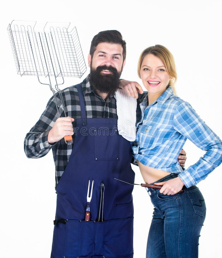 Backyard barbecue party. Cooking together. Essential barbecue dishes. Family getting ready for barbecue. Bearded hipster. And girl hold cooking grilling royalty free stock image