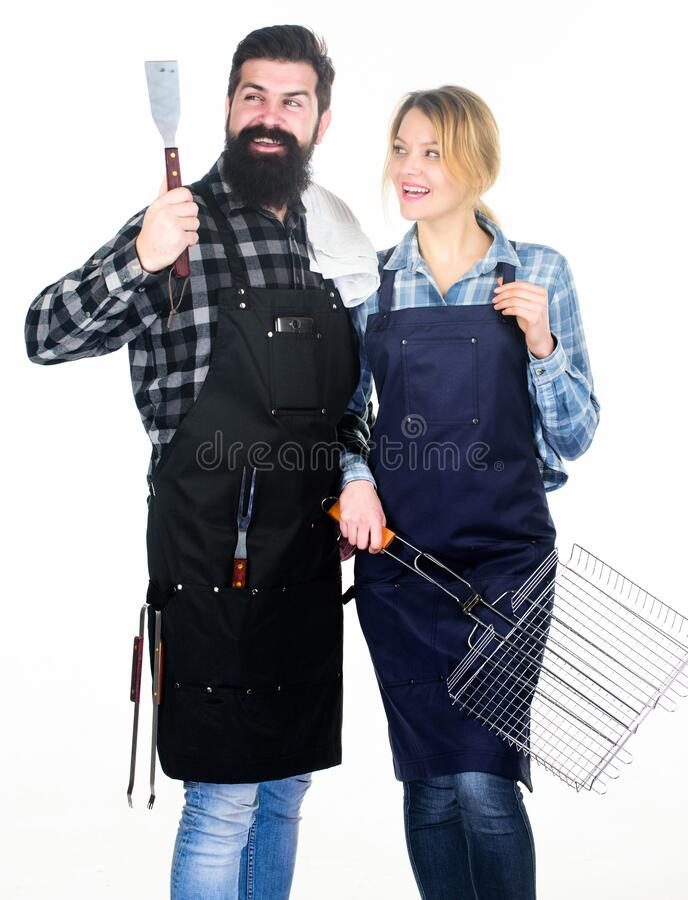 Backyard barbecue party. Family bbq ideas. Couple in love getting ready for barbecue. Picnic and barbecue. Summertime. Leisure. Man bearded hipster and girl royalty free stock photography