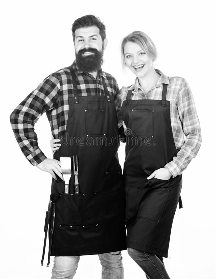 Backyard barbecue party. Family cooking grilled food. Cooking together. Couple in love getting ready for barbecue. Man. Bearded guy and girl ready for barbecue royalty free stock image