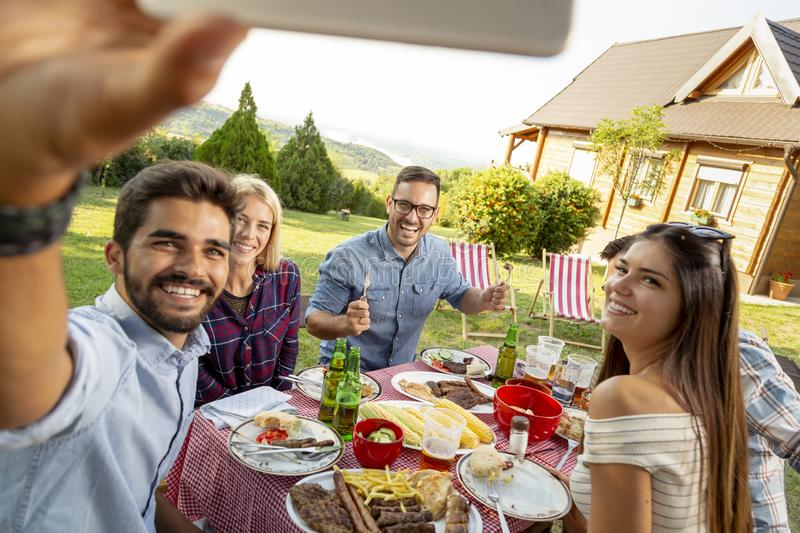 Backyard barbecue party selfie stock photography