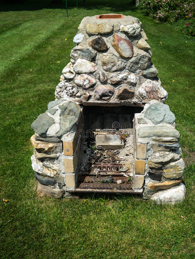 An Old Fashioned BBQ Or Grilling Outdoor Fireplace For Cooking In The  Backyard.
