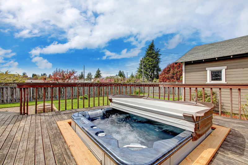 Backyard deck with jacuzzi royalty free stock photography