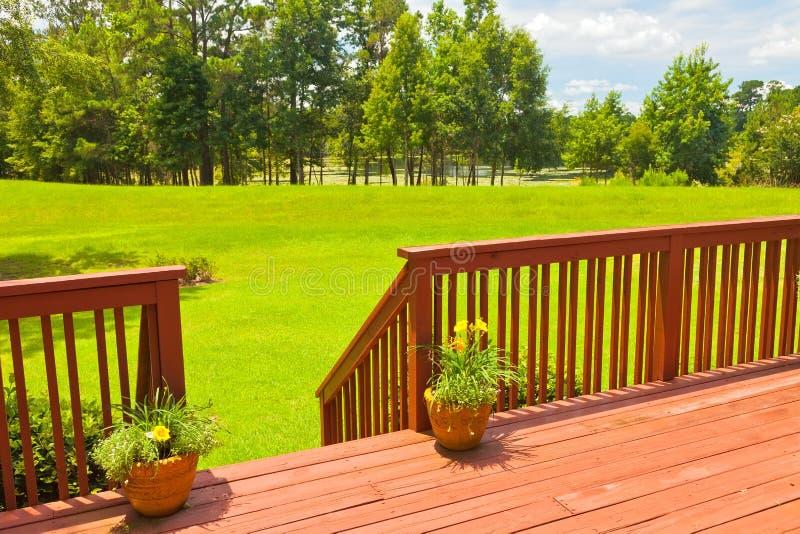 Backyard Deck. Large residential wooden backyard deck stock photography