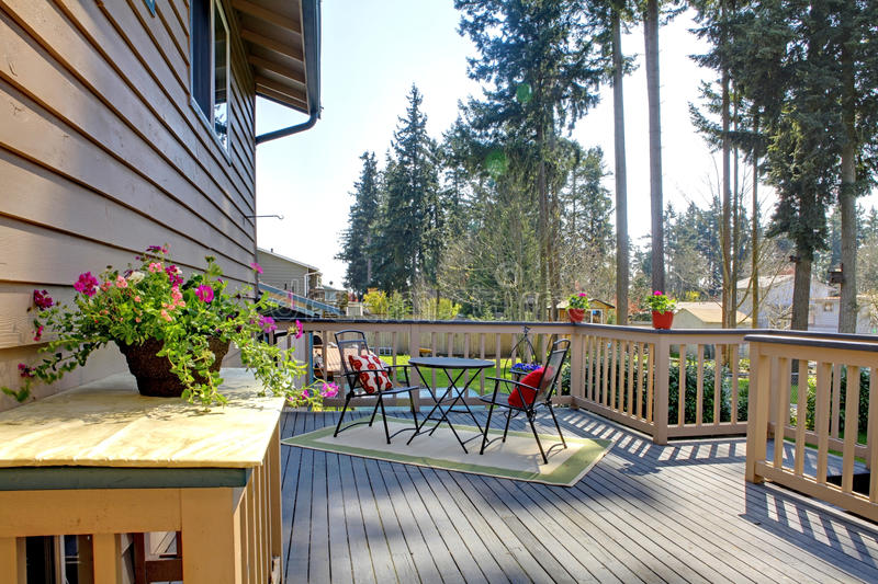 Backyard deck. With table set decorated with flower pots royalty free stock photos