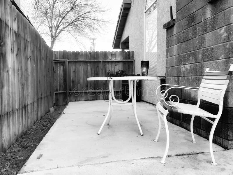 Backyard empty chairs nobody. Nobody home backyard serenity royalty free stock photo
