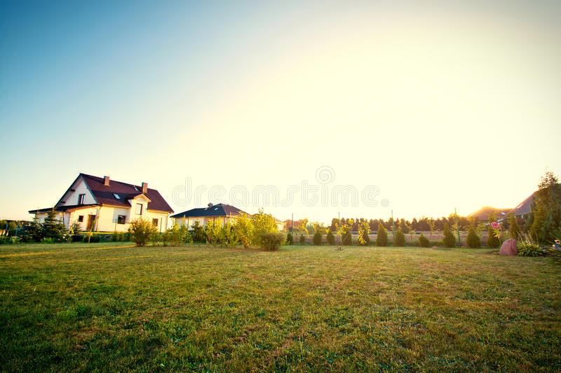Backyard with green grass and sky. royalty free stock photography