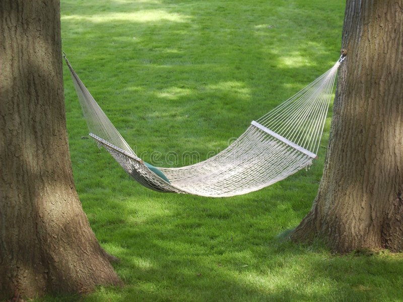 Backyard Hammock. A relaxing place to be on a lazy summer afternoon stock images