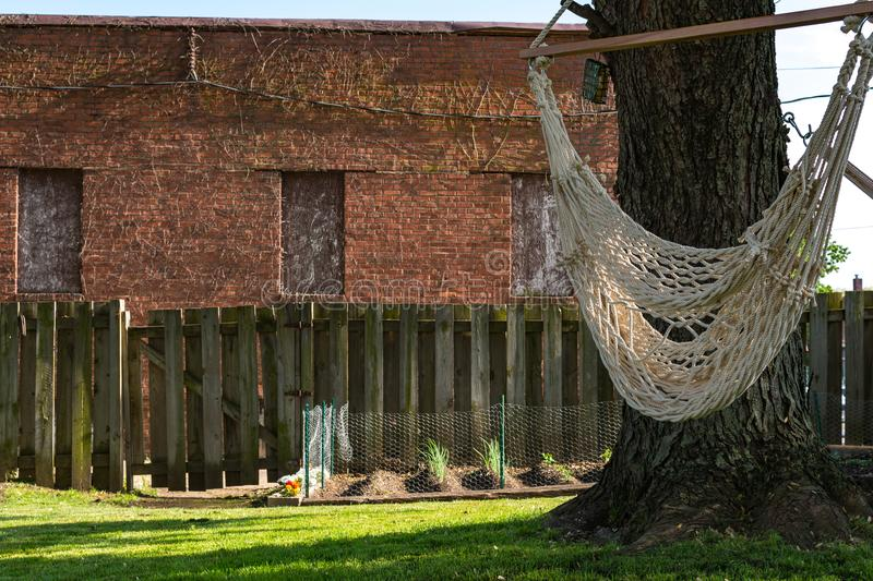 Backyard hammock swing. On a hot spring day. Peru, Illinois stock photo