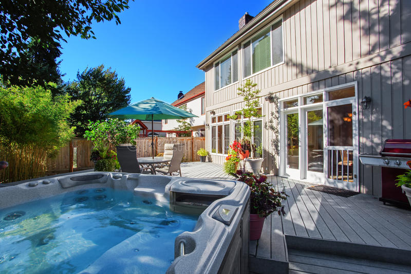 Backyard with jacuzzi and patio area royalty free stock images