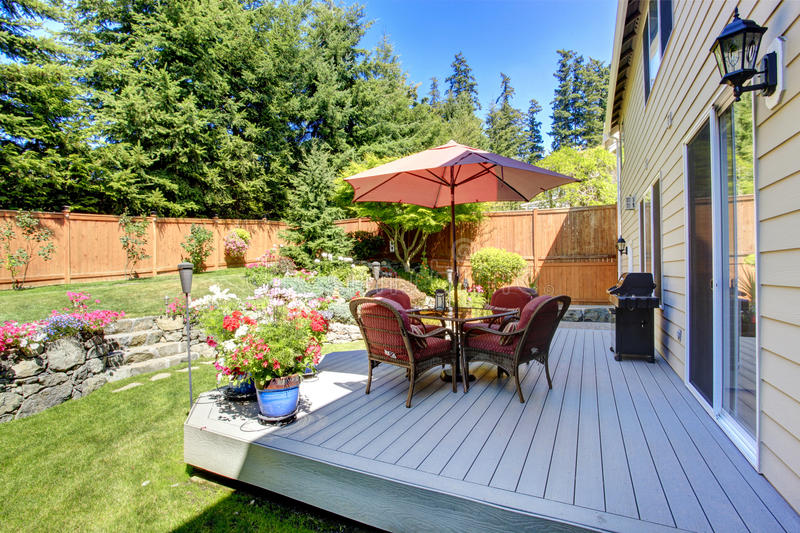 Backyard patio area with landscape royalty free stock photo